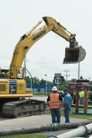 140807 JOED VIERA/STAFF PHOTOGRAPHER-Lockport, NY-A crew works on fixing the sewers at the corner of Robinson Street and Transit Road on Thursday, August 7th.