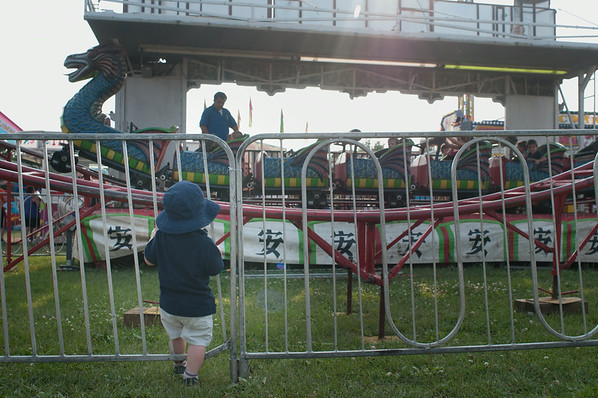 140801 JOED VIERA/STAFF PHOTOGRAPHER-Lockport, NY- Henry Snyder 2 watches a ride at the Niagara County Fair on Friday, August 1st.