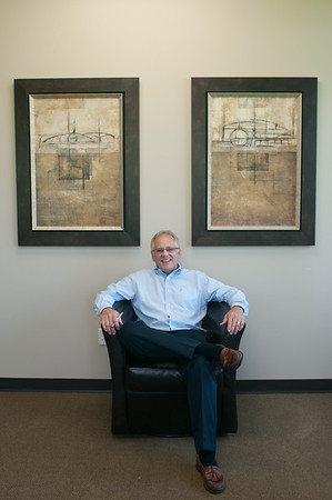 140801 JOED VIERA/STAFF PHOTOGRAPHER-Lockport, NY-Tim Mulvey this years winner of the friend of the YWCA of Niagara Award sits in his office at Mulvey Construction Inc. on Friday, August 1st.