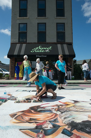 JOED VIERA/STAFF PHOTOGRAPHER-Lockport, NY- Carolyn Schultz  chalks a rendition of Napoleon crossing the Alps at Sweet Chalk Fest on Sunday, August 17th.
