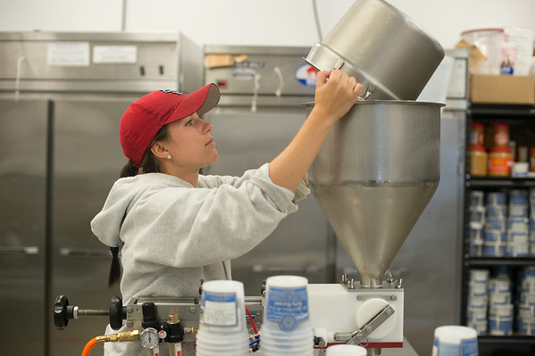 JOED VIERA/STAFF PHOTOGRAPHER-Lockport, NY- Ally Ottaviano makes Salty Caramel Ice Cream at Lake Effect on Thursday, August 14th.