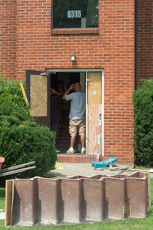 140808 JOED VIERA/STAFF PHOTOGRAPHER-Lockport, NY- Contractors replace the stairs of the apartment building on Friday, August 8th.