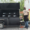 JOED VIERA/STAFF PHOTOGRAPHER-Lockport, NY- Anthony Person owner of the new Big Boss BBQ food truck stands outside the truck as he cooks pork shoulders on Wednesday, August 20th.