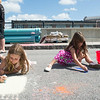 JOED VIERA/STAFF PHOTOGRAPHER-Lockport, NY- Samantha Grzebinski and her sister Alaina draw at  Sweet Chalk Fest on Sunday, August 17th.