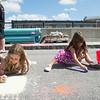 JOED VIERA/STAFF PHOTOGRAPHER-Lockport, NY- Samantha Grzebinski and her sister Alaina draw at  Sweet Chalk Fest on Sunday, August 17th.