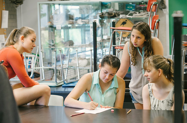 """JOED VIERA/STAFF PHOTOGRAPHER-Lockport, NY- Angela Stewart, Alaina Israel, Lindsey Williams and Christiana Carestia work on the presentation of thier group's product """"Google Mood"""" during the Academy of Finance at Barker High School thier on Tuesday, August 12th."""