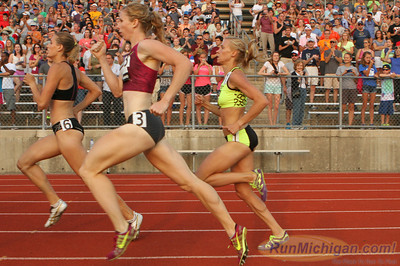 Runners head down the homestretch on the first lap of the SOS Rehydrate Women's 800 at the 2014 Michigan Track Classic.