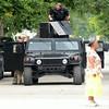 MET081514bays arrest humvee