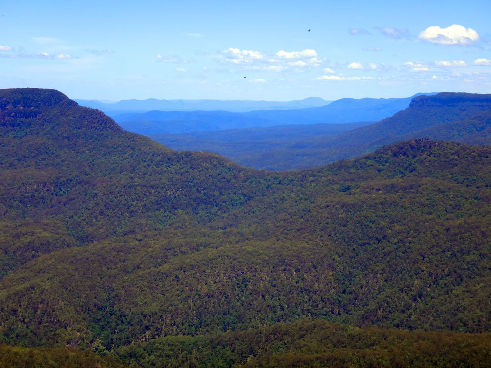 The view from from Echo Point. The haze given off by the eucalyptus oil in the leaves gives the Blue Mountains their name. They are filled with mysterious canyons (hence the sport 'canyoning' involving abseiling and inflatable rafts, etc, which my brother David is seriously into). Several people have been lost forever in the trackless vastness below, as once you're under the canopy, it can be very hard to navigate.