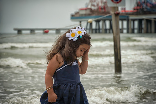 Adorable.. she was a little upset about being in the water and having sand between her toes...
