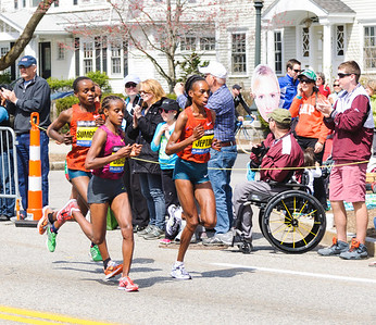 The first four women runners on Heartbreak Hill. Rita Jeptoo (in front) went on to win.