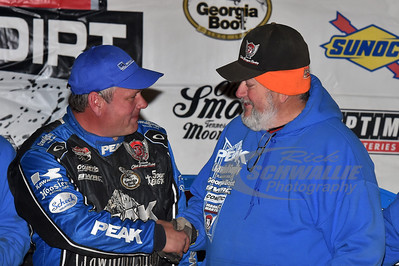 Don O'Neal gets a congratulatory handshake from car builder Barry Wright