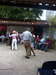 James and Anne Gay dancing with locals at a private music concert in Paraty, Brazil