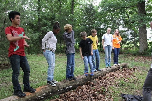 Monday, June 9: CIP at the Low Ropes course. Josh is third from left in the grey sweatshirt.