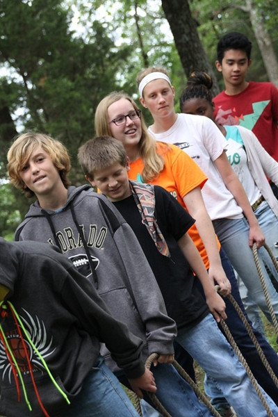 Monday, June 9: CIP at the Low Ropes course. Joshua's group learn to work together on the walking sticks.