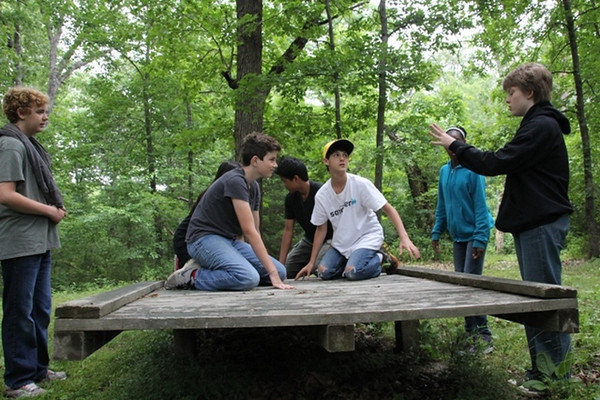 Monday, June 9: CIP at the Low Ropes course. Elijah on the right helping his group get everyone on the balance board.