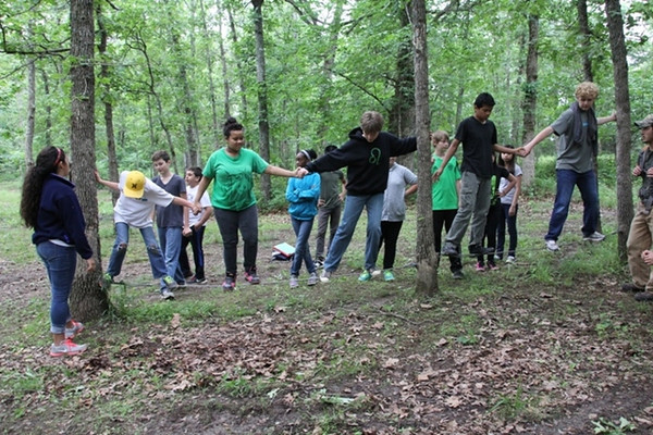 Monday, June 9: CIP at the Low Ropes course. Elijah is on the far right standing on the rope.