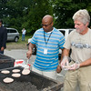 NECSD Board of Education President Philip F. Howard flips burgers as board member Kenneth Copertino assists at the Newburgh Enlarged City School District sponsored Back-to-School Backpack BBQ at the BOE/Library on Grand St in Newburgh on Saturday, August 23, 2014. Hudson Valley Press/CHUCK STEWART, JR.