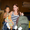 Four-year-old Madison with her mother Amber Rosario, picked up a bookbag at the Newburgh Enlarged City School District sponsored Back-to-School Backpack BBQ at the BOE/Library on Grand St in Newburgh on Saturday, August 23, 2014. Hudson Valley Press/CHUCK STEWART, JR.