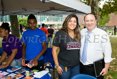 Christina Soto of Planned Parenthood Mid Hudson Valley with NYS Assemblyman Frank Skartados at the Newburgh Enlarged City School District sponsored Back-to-School Backpack BBQ at the BOE/Library on Grand St in Newburgh on Saturday, August 23, 2014. Hudson Valley Press/CHUCK STEWART, JR.