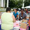 People receive information from Occupations workers Jodi Palazzo, Natasha Carmona and Manouska Archer at the Newburgh Enlarged City School District sponsored Back-to-School Backpack BBQ at the BOE/Library on Grand St in Newburgh on Saturday, August 23, 2014. Hudson Valley Press/CHUCK STEWART, JR.