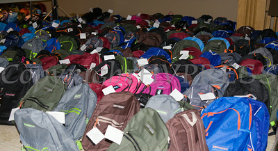 600 backpacks were lined up for distribution at the Newburgh Enlarged City School District sponsored Back-to-School Backpack BBQ at the BOE/Library on Grand St in Newburgh on Saturday, August 23, 2014. Hudson Valley Press/CHUCK STEWART, JR.