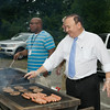 NECSD Board of Education President Philip F. Howard flips burgers as board member Kenneth Copertino assists and Assemblyman Frank Skartados lends a hand at the Newburgh Enlarged City School District sponsored Back-to-School Backpack BBQ at the BOE/Library on Grand St in Newburgh on Saturday, August 23, 2014. Hudson Valley Press/CHUCK STEWART, JR.
