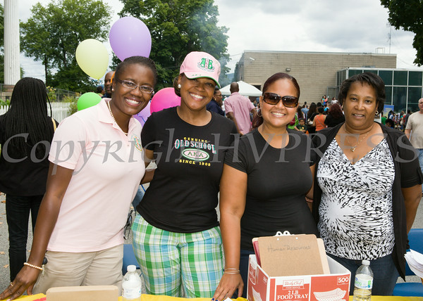 Members of the Iota Alpha Omega Chapter of Alpha Kappa Alpha Sorority, Inc Nadia Rahaman and Sonya Fiol-Grant with NECSD member Chastity Beato and Volunteer Melody Taylor at the Newburgh Enlarged City School District sponsored Back-to-School Backpack BBQ at the BOE/Library on Grand St in Newburgh on Saturday, August 23, 2014. Hudson Valley Press/CHUCK STEWART, JR.