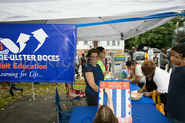 People receive information from Orange-Ulster BOCES at the Newburgh Enlarged City School District sponsored Back-to-School Backpack BBQ at the BOE/Library on Grand St in Newburgh on Saturday, August 23, 2014. Hudson Valley Press/CHUCK STEWART, JR.