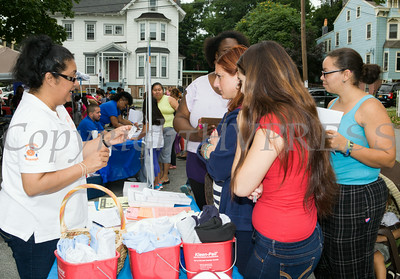 People receive information from Orange County Dept of Health's Healthy Orange program at the Newburgh Enlarged City School District sponsored Back-to-School Backpack BBQ at the BOE/Library on Grand St in Newburgh on Saturday, August 23, 2014. Hudson Valley Press/CHUCK STEWART, JR.