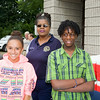 Iliana Lopez, security officer Mrs. Green and Anthony Grice enjooy the Newburgh Enlarged City School District sponsored Back-to-School Backpack BBQ at the BOE/Library on Grand St in Newburgh on Saturday, August 23, 2014. Hudson Valley Press/CHUCK STEWART, JR.