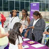 People receive information from Best Resources Center at the Newburgh Enlarged City School District sponsored Back-to-School Backpack BBQ at the BOE/Library on Grand St in Newburgh on Saturday, August 23, 2014. Hudson Valley Press/CHUCK STEWART, JR.
