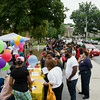 Hundreds of people line up on Grand Street as the Newburgh Enlarged City School District hosted a Back-to-School Backpack BBQ at the BOE/Library in Newburgh on Saturday, August 23, 2014. Hudson Valley Press/CHUCK STEWART, JR.