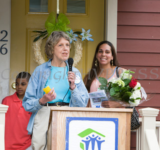 Family Advocate Pat Parker introduces the Spearman family as Habitat for Humanity of Greater Newburgh dedicated the Spearman and Martinez homes on East Parmenter St. in the City of Newburgh on Saturday, June 14, 2014 to complete the week long Builders Blitz. Hudson Valley Press/CHUCK STEWART, JR.