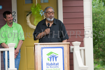 Pastor James Stewart of Harvest Christian Community Church offers a blessing of the homes and neighborhood following Habitat for Humanity of Greater Newburgh's dedication of the Spearman and Martinez homes on East Parmenter St. in the City of Newburgh on Saturday, June 14, 2014 to complete the week long Builders Blitz. Hudson Valley Press/CHUCK STEWART, JR.