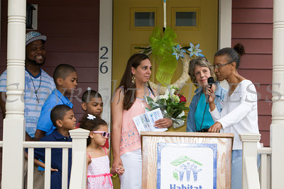 Family Advocate Sharon Gamble introduces the Spearman family and presents them with a Bible as Habitat for Humanity of Greater Newburgh dedicated the Spearman and Martinez homes on East Parmenter St. in the City of Newburgh on Saturday, June 14, 2014 to complete the week long Builders Blitz. Hudson Valley Press/CHUCK STEWART, JR.
