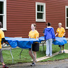 Volunteers prepare for the block party that followed Habitat for Humanity of Greater Newburgh's dedication of the Spearman and Martinez homes on East Parmenter St. in the City of Newburgh on Saturday, June 14, 2014 to complete the week long Builders Blitz. Hudson Valley Press/CHUCK STEWART, JR.