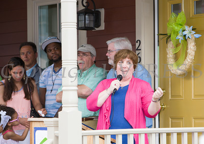 Cathy Collins, Executive Director, HfHGN offers remarks as Habitat for Humanity of Greater Newburgh dedicated the Spearman and Martinez homes on East Parmenter St. in the City of Newburgh on Saturday, June 14, 2014 to complete the week long Builders Blitz. Hudson Valley Press/CHUCK STEWART, JR.
