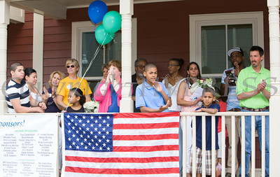 Habitat for Humanity of Greater Newburgh dedicated the Spearman and Martinez homes on East Parmenter St. in the City of Newburgh on Saturday, June 14, 2014 to complete the week long Builders Blitz. Hudson Valley Press/CHUCK STEWART, JR.