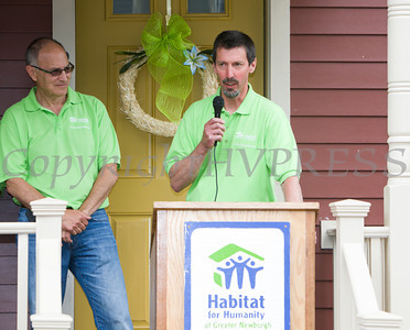 Andy Stahl of Hearthstone offers remarks as Habitat for Humanity of Greater Newburgh dedicated the Spearman and Martinez homes on East Parmenter St. in the City of Newburgh on Saturday, June 14, 2014 to complete the week long Builders Blitz. Hudson Valley Press/CHUCK STEWART, JR.