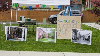 Photos were on display showing what East Parementer Street looked like years ago as Habitat for Humanity of Greater Newburgh dedicated the Spearman and Martinez homes on East Parmenter St. in the City of Newburgh on Saturday, June 14, 2014 to complete the week long Builders Blitz. Hudson Valley Press/CHUCK STEWART, JR.
