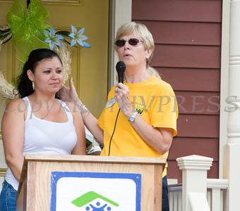 Family Advocate Judy Burn introduces the Martinez family as Habitat for Humanity of Greater Newburgh dedicated the Spearman and Martinez homes on East Parmenter St. in the City of Newburgh on Saturday, June 14, 2014 to complete the week long Builders Blitz. Hudson Valley Press/CHUCK STEWART, JR.