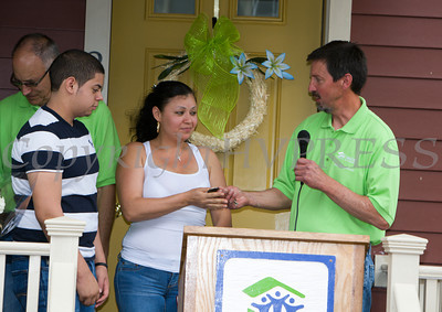 Andy Stahl of Hearthstone presents the keys to the Martinez family as Habitat for Humanity of Greater Newburgh dedicated the Spearman and Martinez homes on East Parmenter St. in the City of Newburgh on Saturday, June 14, 2014 to complete the week long Builders Blitz. Hudson Valley Press/CHUCK STEWART, JR.
