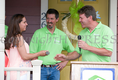Ian Rieger of Rieger Homes presents the keys to the Spearman family as Habitat for Humanity of Greater Newburgh dedicated the Spearman and Martinez homes on East Parmenter St. in the City of Newburgh on Saturday, June 14, 2014 to complete the week long Builders Blitz. Hudson Valley Press/CHUCK STEWART, JR.