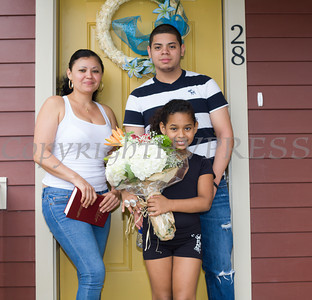 The Martinez family poses for a picture in front of their new home following Habitat for Humanity of Greater Newburgh's dedication on East Parmenter St. in the City of Newburgh on Saturday, June 14, 2014 to complete the week long Builders Blitz. Hudson Valley Press/CHUCK STEWART, JR.