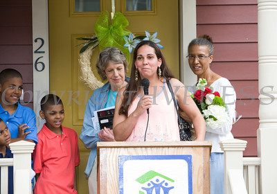 Mrs. Spearman offers remarks as Habitat for Humanity of Greater Newburgh dedicated the Spearman and Martinez homes on East Parmenter St. in the City of Newburgh on Saturday, June 14, 2014 to complete the week long Builders Blitz. Hudson Valley Press/CHUCK STEWART, JR.
