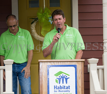 Ian Rieger of Rieger Homes offers remarks as Habitat for Humanity of Greater Newburgh dedicated the Spearman and Martinez homes on East Parmenter St. in the City of Newburgh on Saturday, June 14, 2014 to complete the week long Builders Blitz. Hudson Valley Press/CHUCK STEWART, JR.