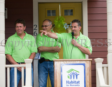 Bob Colucci of Ultimate Homes offers remarks as Habitat for Humanity of Greater Newburgh dedicated the Spearman and Martinez homes on East Parmenter St. in the City of Newburgh on Saturday, June 14, 2014 to complete the week long Builders Blitz. Hudson Valley Press/CHUCK STEWART, JR.