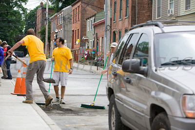 Volunteers clean up before Habitat for Humanity of Greater Newburgh dedicated the Spearman and Martinez homes on East Parmenter St. in the City of Newburgh on Saturday, June 14, 2014 to complete the week long Builders Blitz. Hudson Valley Press/CHUCK STEWART, JR.