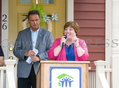 Cathy Collins, Executive Director, HfHGN introduces Sammy Fratto, International Brotherhood of Electrical Workers Local 363, who offered remarks as Habitat for Humanity of Greater Newburgh dedicated the Spearman and Martinez homes on East Parmenter St. in the City of Newburgh on Saturday, June 14, 2014 to complete the week long Builders Blitz. Hudson Valley Press/CHUCK STEWART, JR.